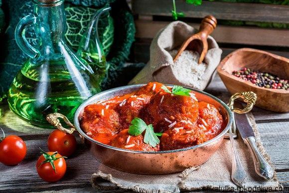Хек под томатным соусом